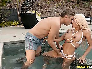 buxom bikini babe heads deep anal invasion with a cording fellow