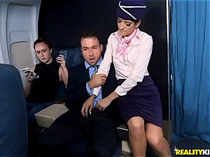 Air hostess Lexy Rose takes a prick pouch deep on the flat