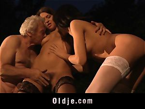 grandpa gets drilled by two lovelies