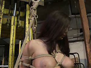 Kathia Nobili smacking the rump of steamy doll with cane