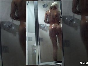 Home flick of Nikita Von James taking a shower