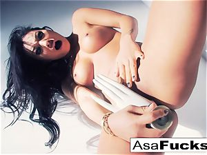 Asa Akira uses a fake hand to sate her cunny