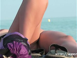 A thrilling naked beach voyeur spy web cam movie