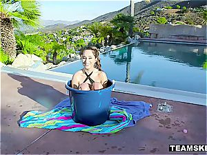 little teenage plaything gets carried around in a bucket